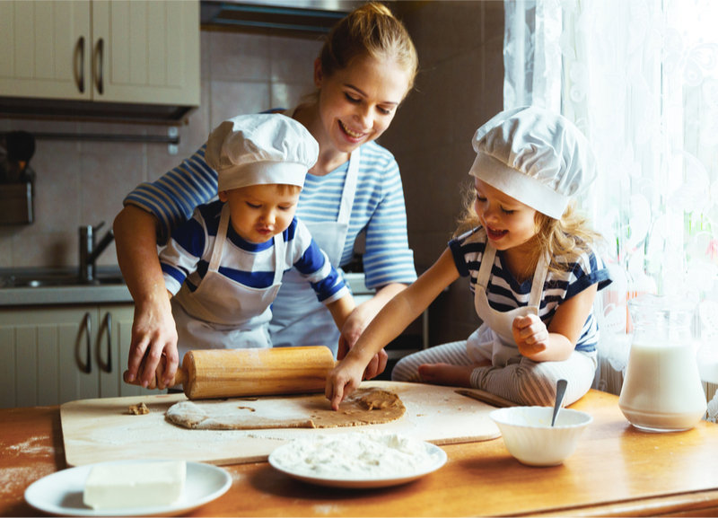 Authoritative parent helping the child in baking